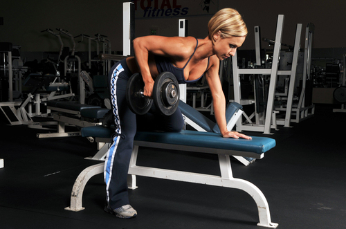 Woman lifting a heavy dumbbell